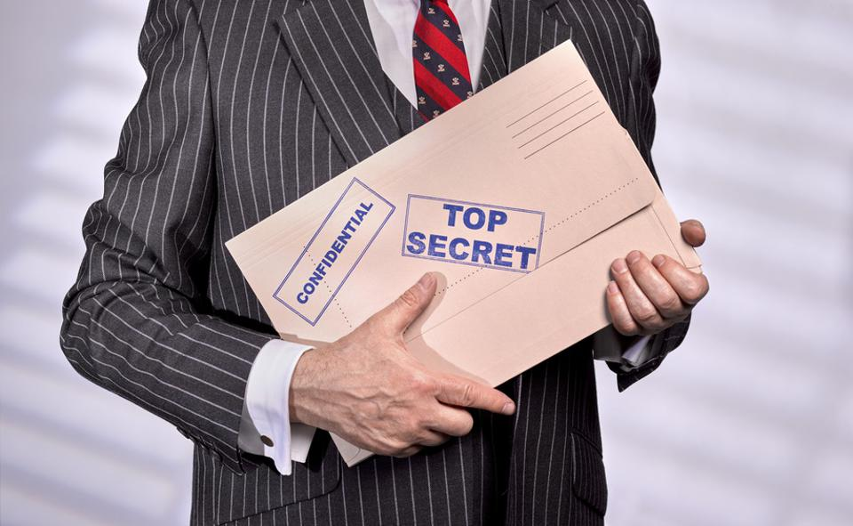 Businessman holding Confidential Top Secret Folder