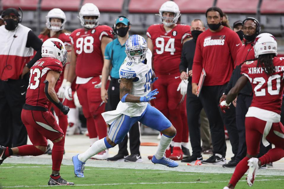 GLENDALE, ARIZONA - SEPTEMBER 27:  Wide receiver Kenny Golladay #19 of the Detroit Lions runs with the football after a reception against cornerback Byron Murphy #33 of the Arizona Cardinals in the NFL game at State Farm Stadium on September 27, 2020 in Glendale, Arizona.  The Lions defeated the Cardinals 26-23. (Photo by Christian Petersen/Getty Images)
