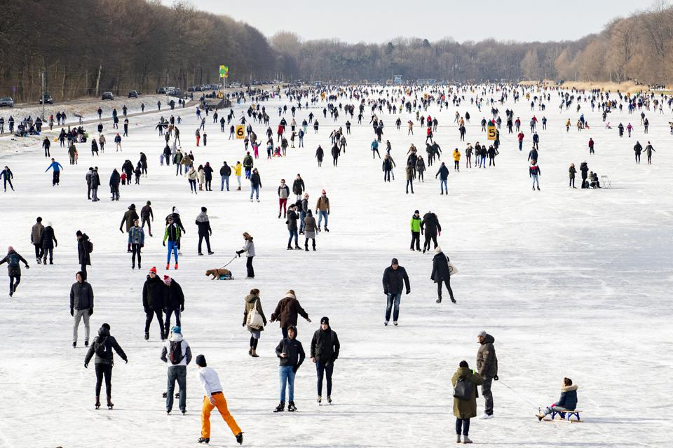 Skaters on the Bosbaan on February 14, 2021 in Amsterdam, Netherlands.