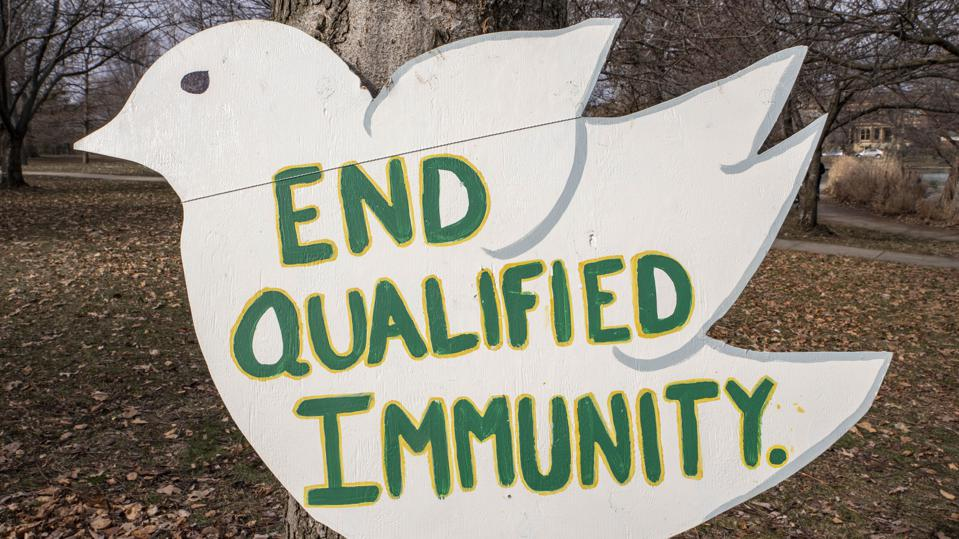 Sign reading  ″End Qualified Immunity″, Qualified Immunity...