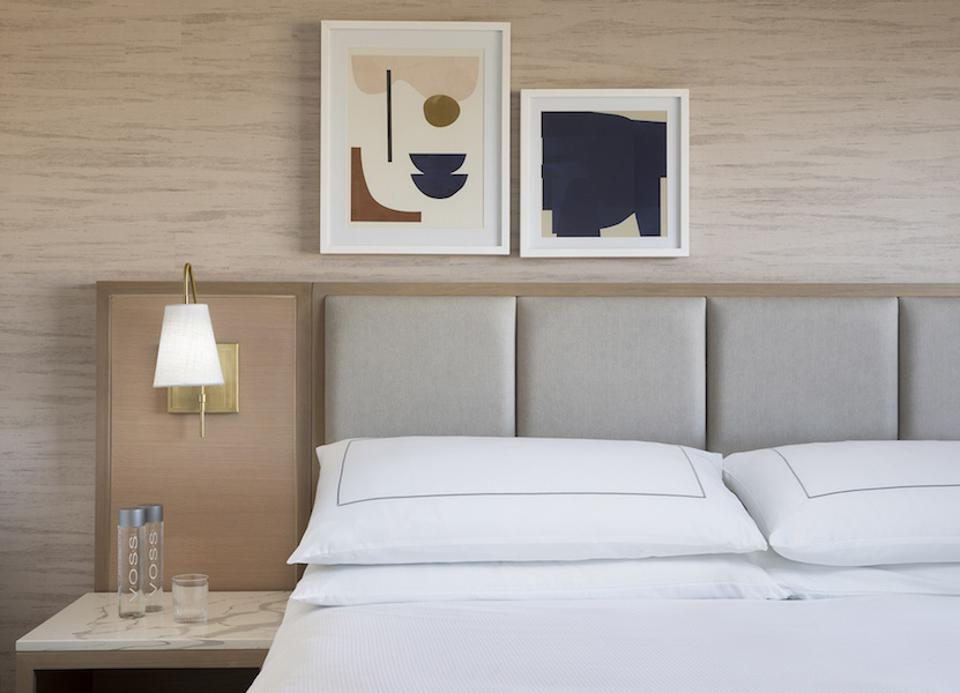 A close up of a bed and nightstand