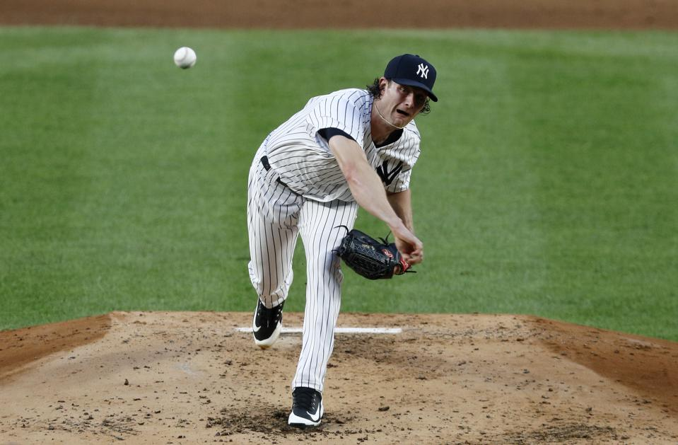 Right-handed pitcher Gerrit Cole throws a pitch on the mound at Yankee Stadium.