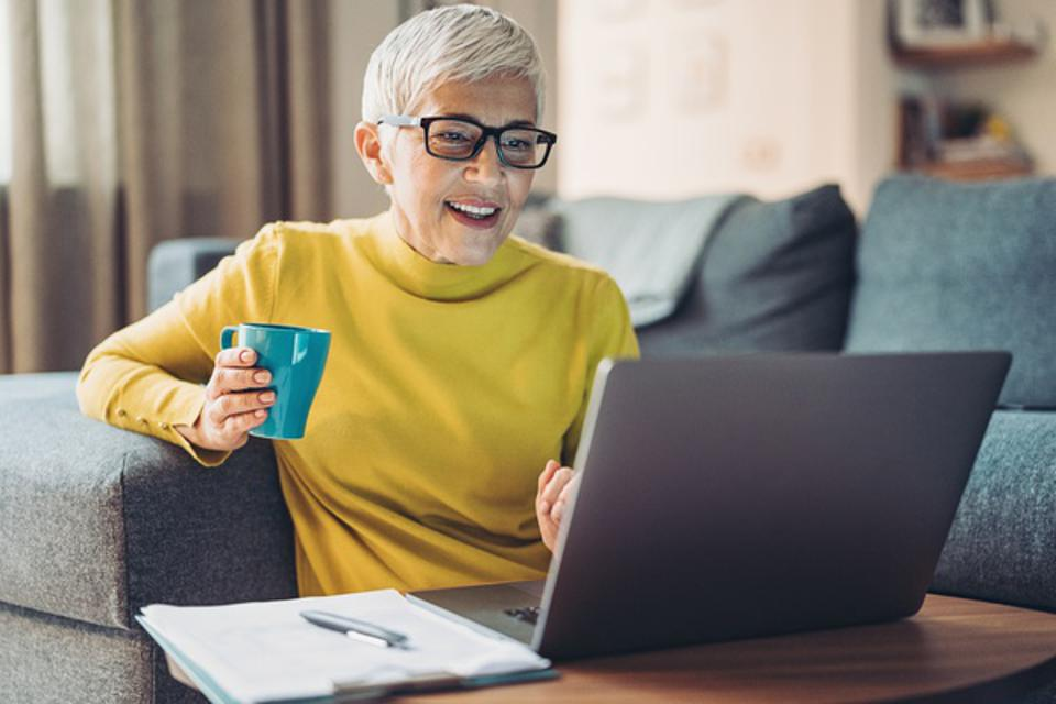 Mature woman working from the comfort of her home