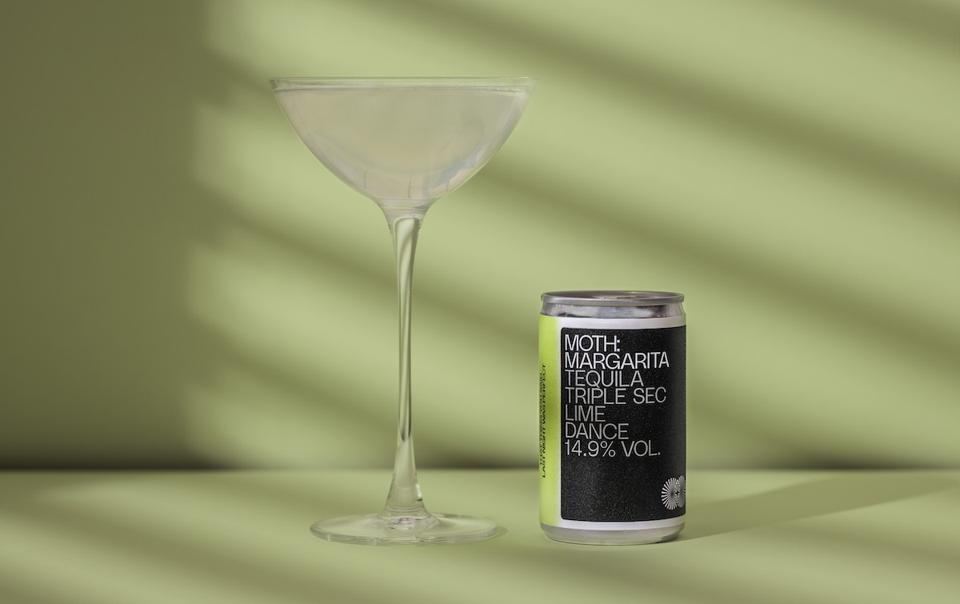 canned cocktail and glass