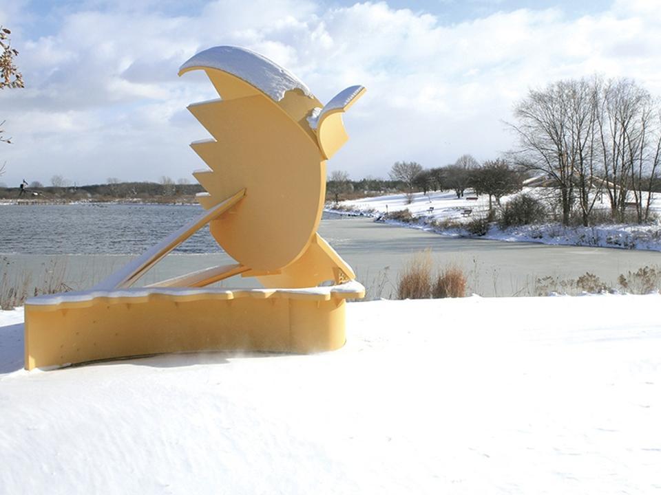 yellow sculpture in snow