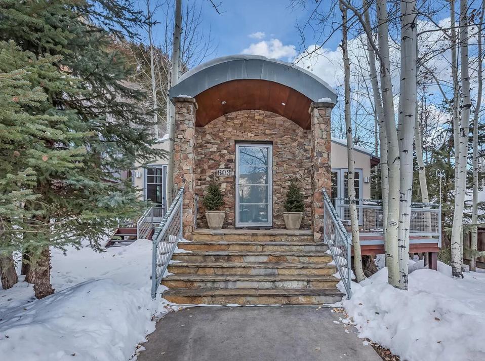 entrance to luxury aspen home at 603 s garmisch st colorado