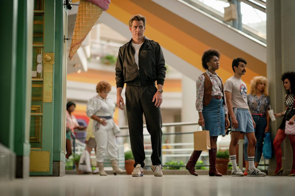 """CHRIS PINE as Steve Trevor looks out of place  in a 1984 mall in  """"WONDER WOMAN 1984,"""" a Warner Bros. Pictures release."""