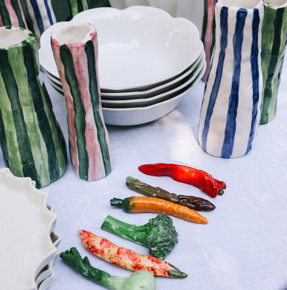 porcelain cutlery rests in the shape of vegetables together with some vases and bowls