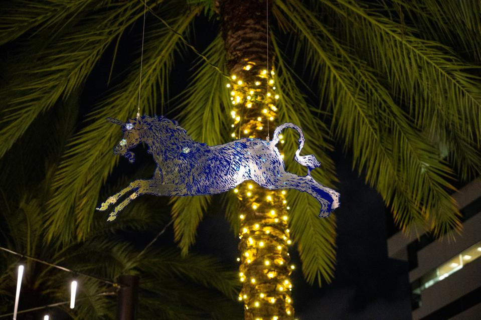 horse hanging from tree