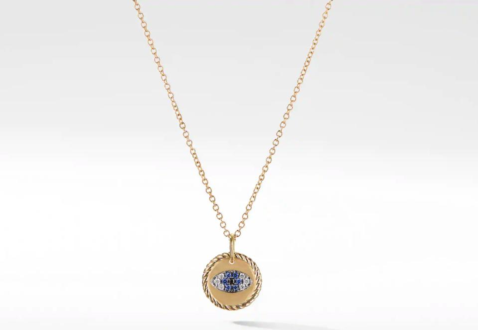 Gold chain necklace with gold plated charm with blue sapphire and diamond evil eye