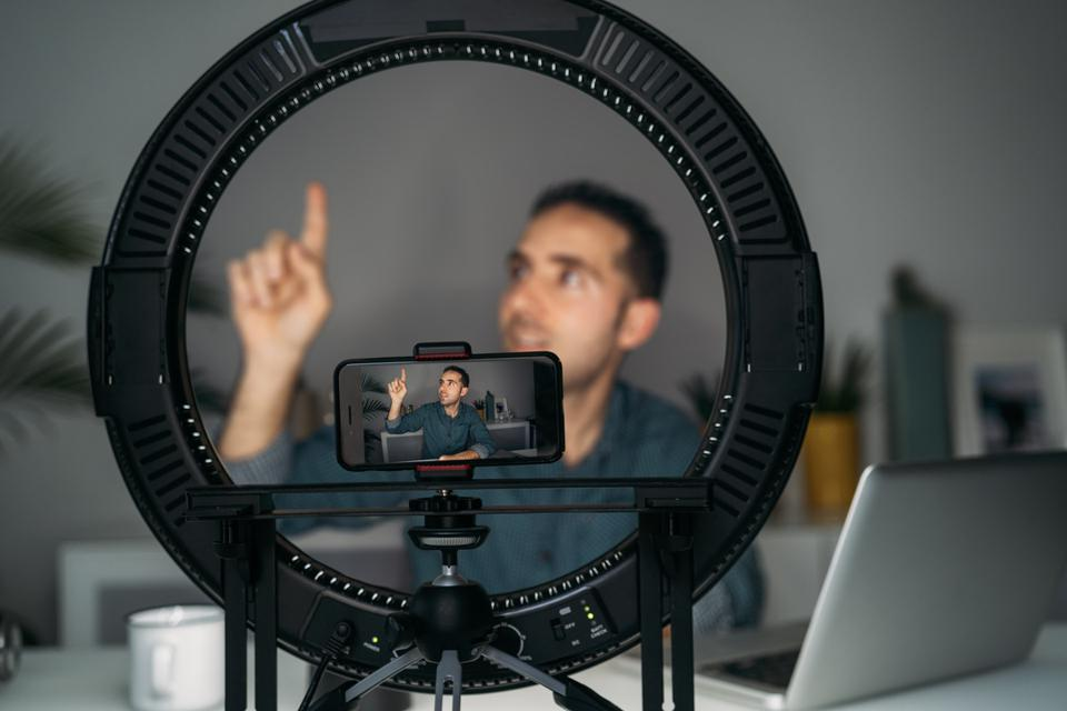 Vlogger filming with smartpone at home