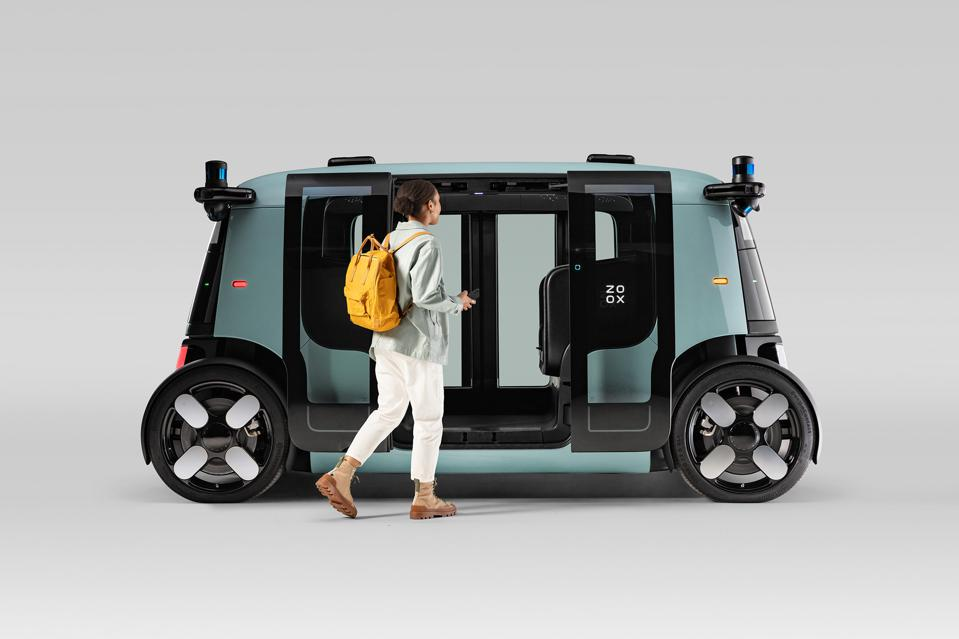 Person entering Zoox robotaxi, self-driving electric transportation vehicle