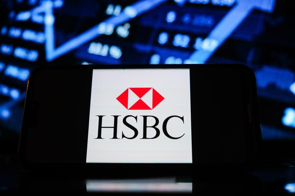 In this photo illustration a HSBC bank logo seen displayed...