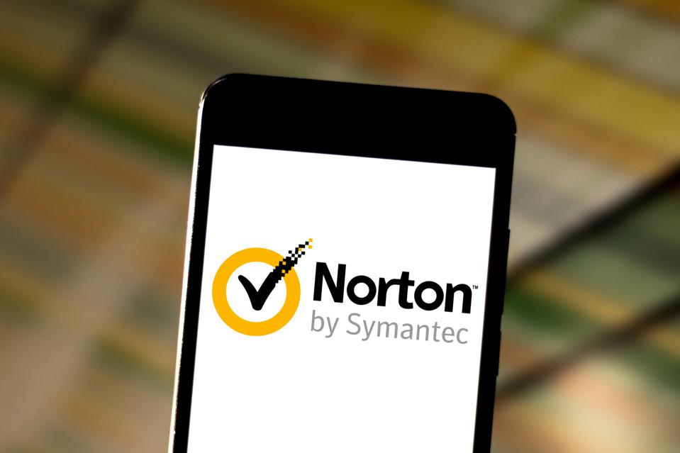 In this photo illustration a Norton Antivirus (NAV) logo...