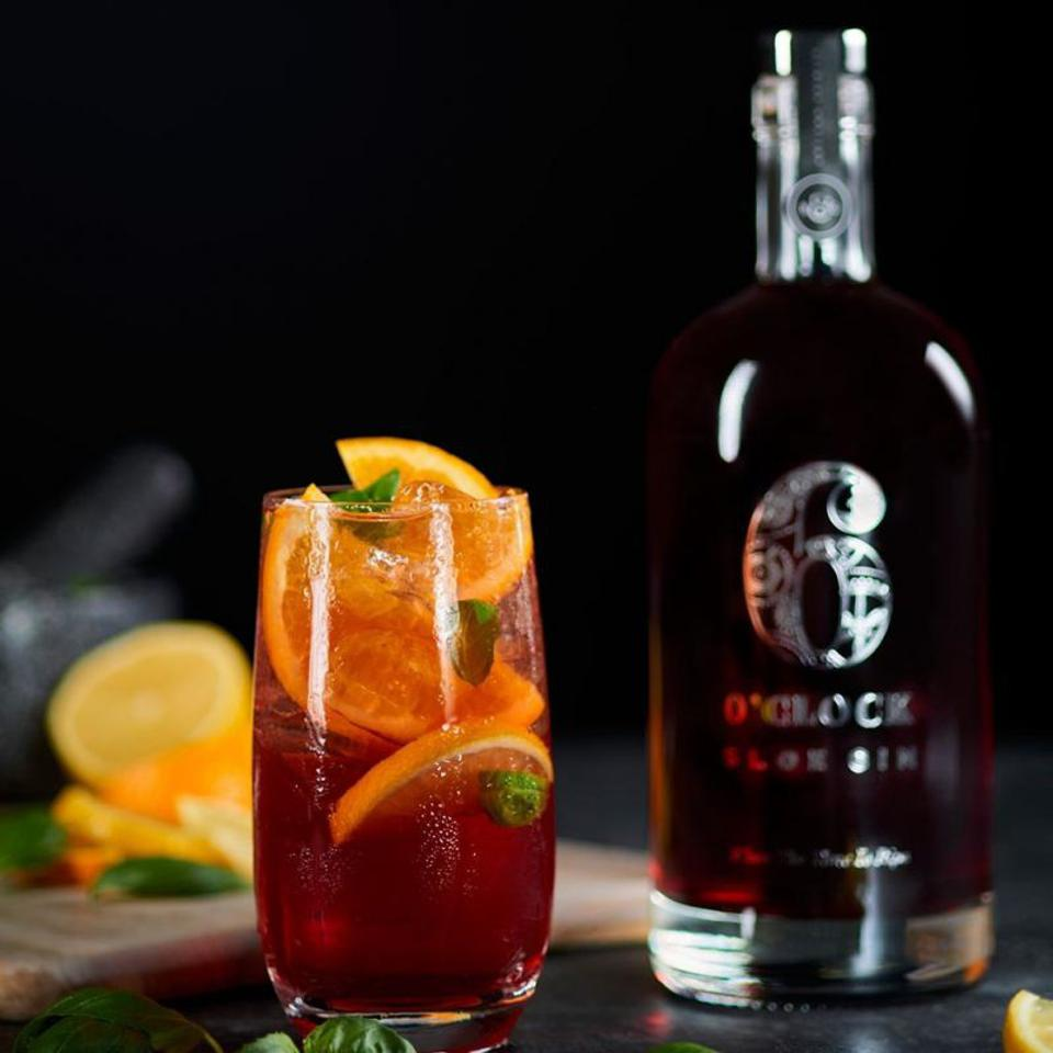 Bottle of 6 O'Clock Sloe Gin with cocktail