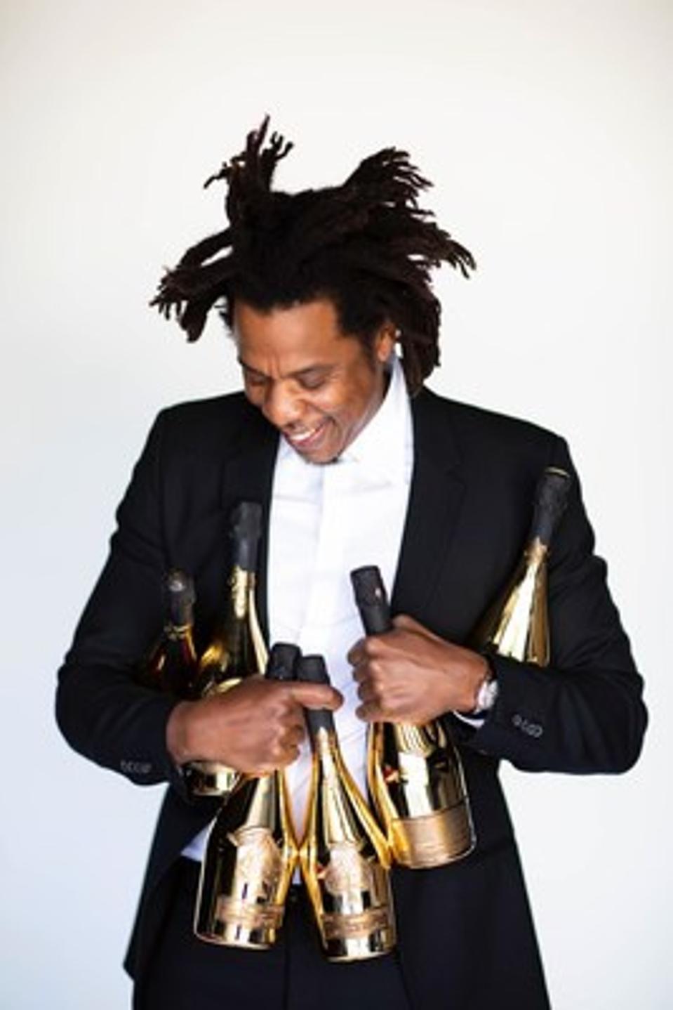 Jay-Z holds Ace of Spades bottles.