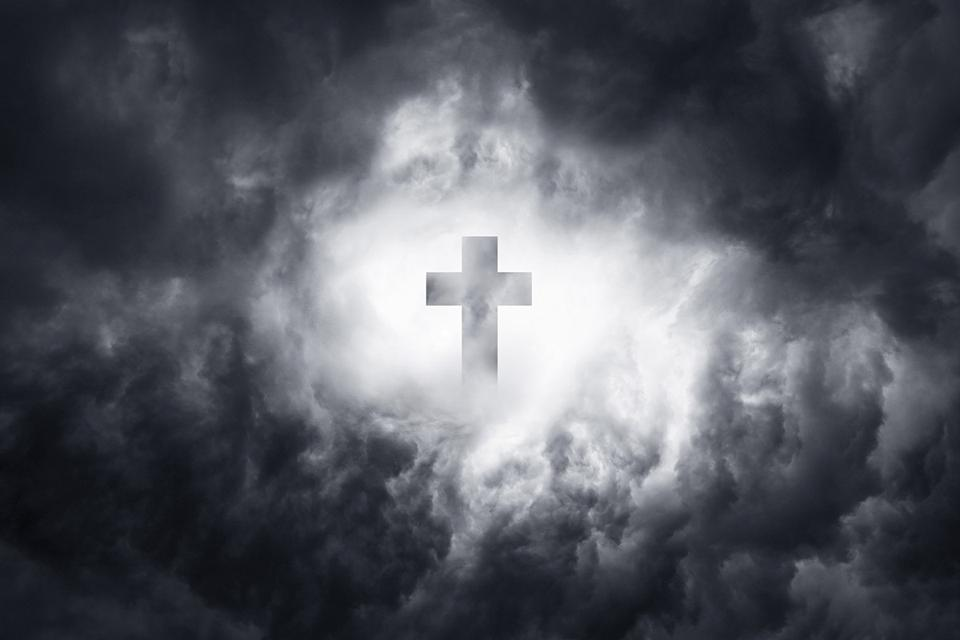 Symbol of Christianity in a stormy sky as the salvation of the earth and the soul of people. Thunderclouds and the path into the clouds to God.