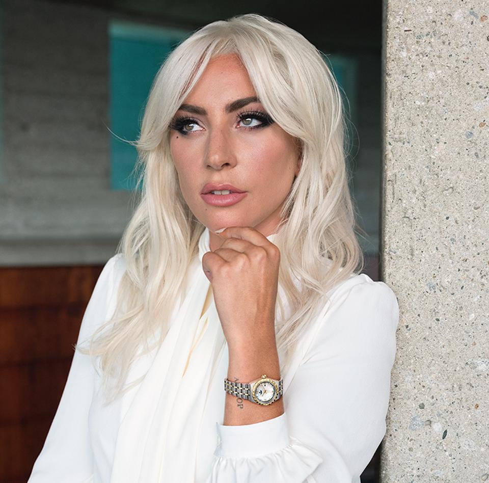 Lady Gaga wears a Tudor Royal two-tone with diamond markers.