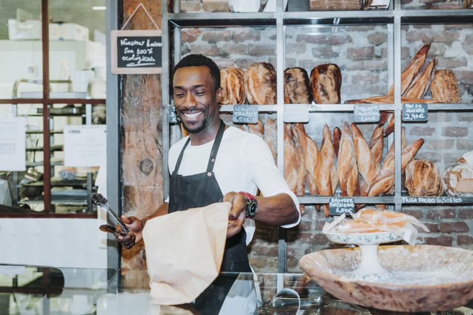 Smiling man working in a bakery