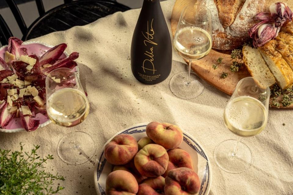 Della Vite Prosecco alongside a simple Italian farmhouse spread.