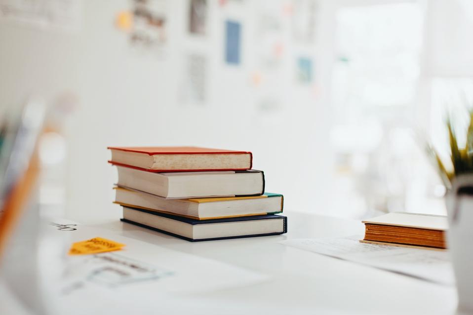 Books on desk in modern design office