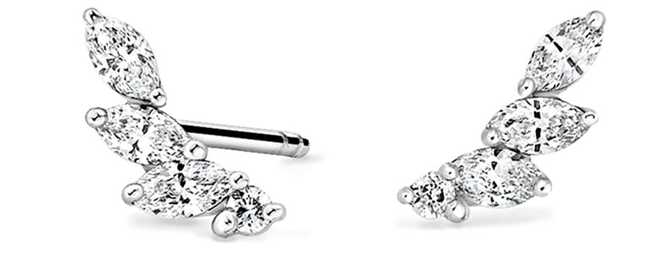 Round and marquise diamonds rest in a curved row in these dazzling crawler earrings (1/5 total carat weight).
