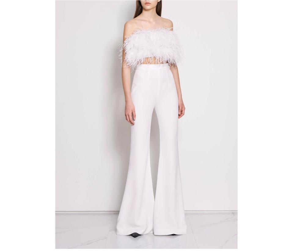 This feathered crop top from Nicole by NF is a perfect yet versatile piece to celebrate your engagement, bridal shower or wedding day in modern style.