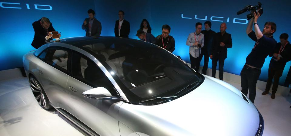 Journalists look over the new ″air″ electric car by Lucid Motors Inc. on Dec. 14, 2016