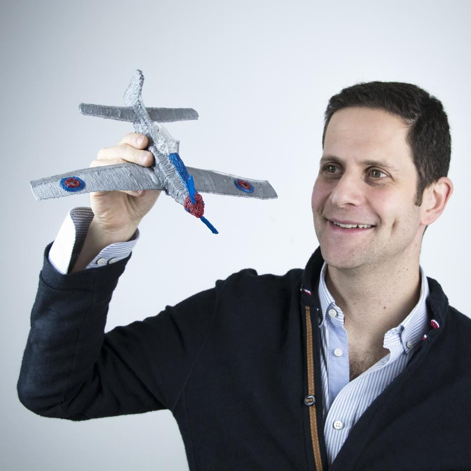 Daniel Cowen, Co-Founder and CEO of 3Doodler, holds in his hand an airplane made with a 3D pen.