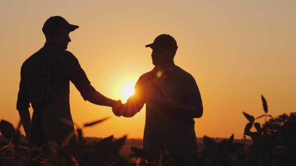 Two farmers shaking hands.