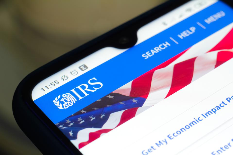 In this photo illustration the Internal Revenue Service (IRS...