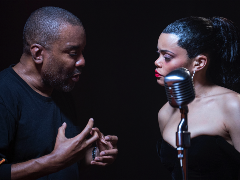 Lee Daniels and Andra Day speaking while filming 'The United States vs. Billie Holiday'