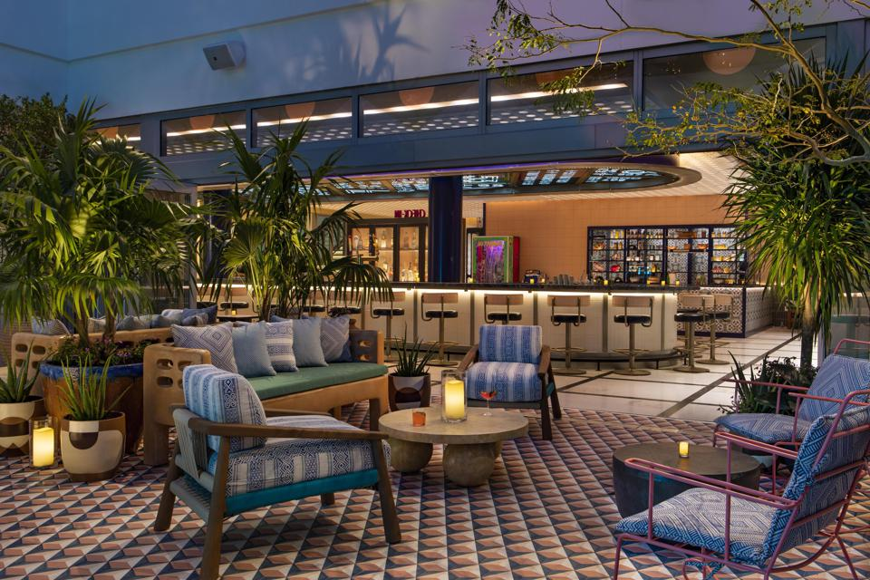 A colorful, lushly planted courtyard takes center stage on the hotel's lobby level.