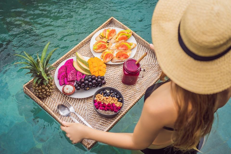 Breakfast tray in swimming pool, floating breakfast in luxury hotel.