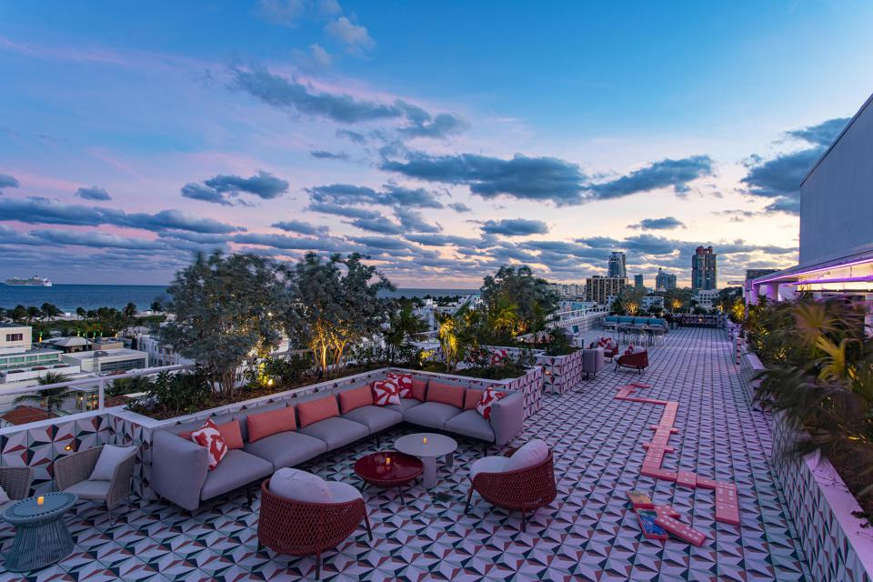 The hotel's sprawling rooftop bar is comprised of multiple seating areas and offers panoramic views of Miami Beach.