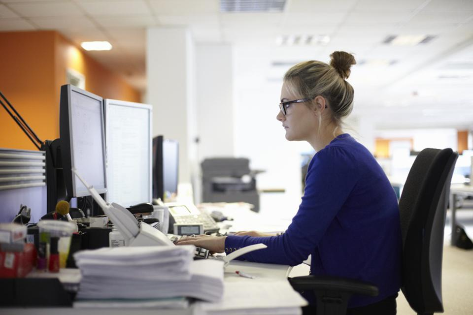 Young woman using computer in office