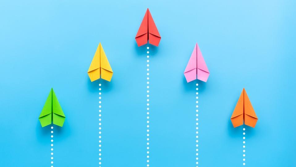 Small wins shown through paper plane illustration