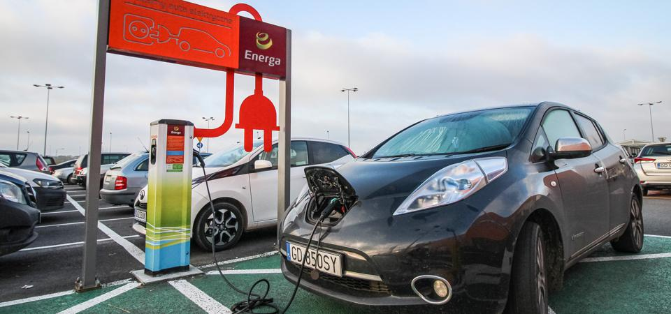 Nissan Leaf Connected To An Electric Charger