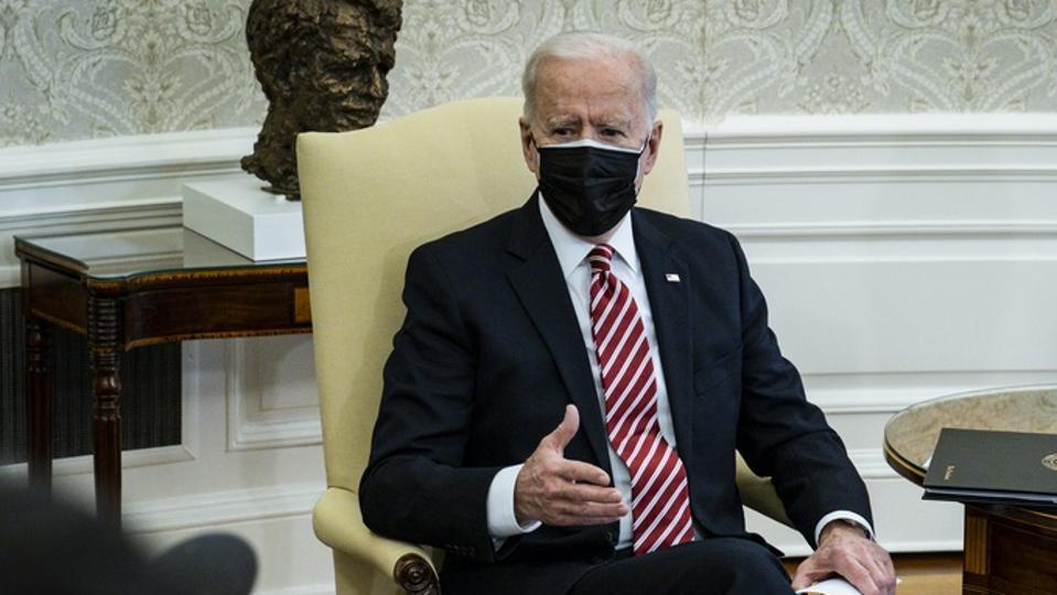 President Joe Biden wearing face mask in Oval Office