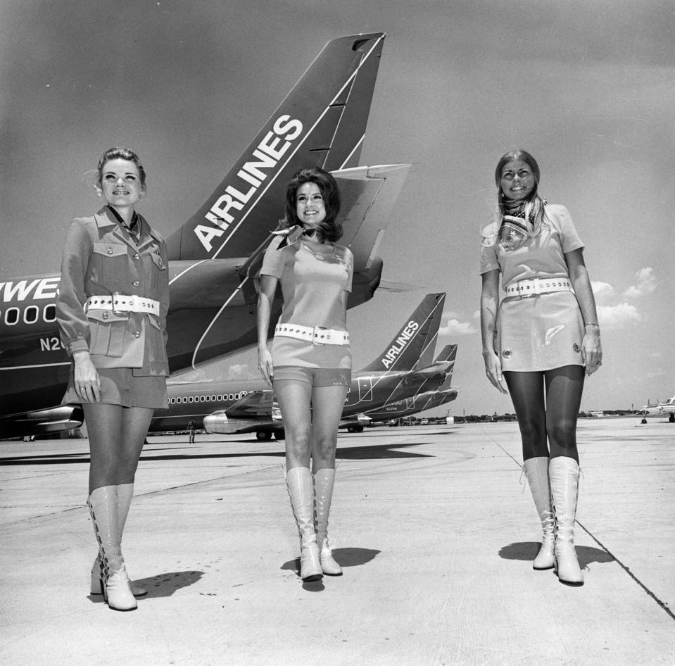 Southwest Airlines flight attendants circa 1970 in front of early 737 aircraft.