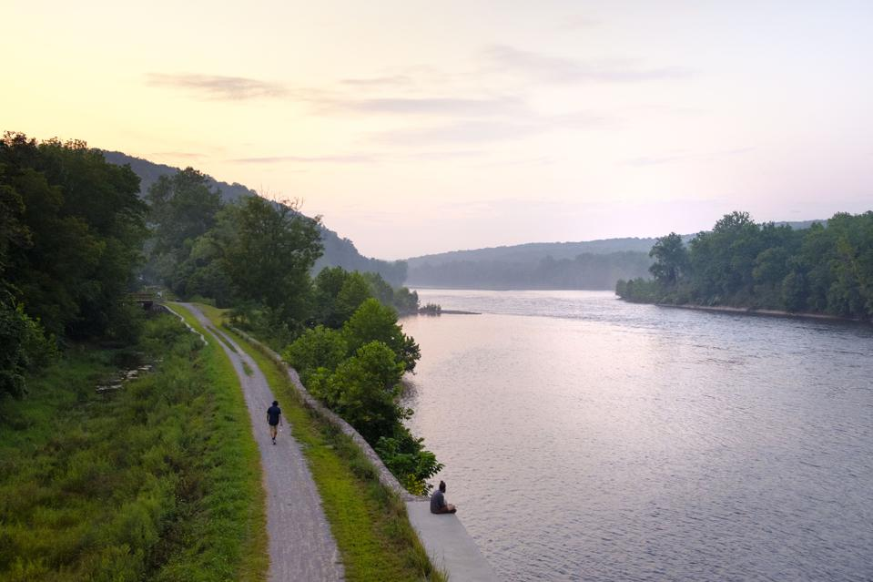 View from PA to NJ over Delaware River, at sunset with cycling path, part of the Delaware and Raritan Canal State Park, New Jersey, USA