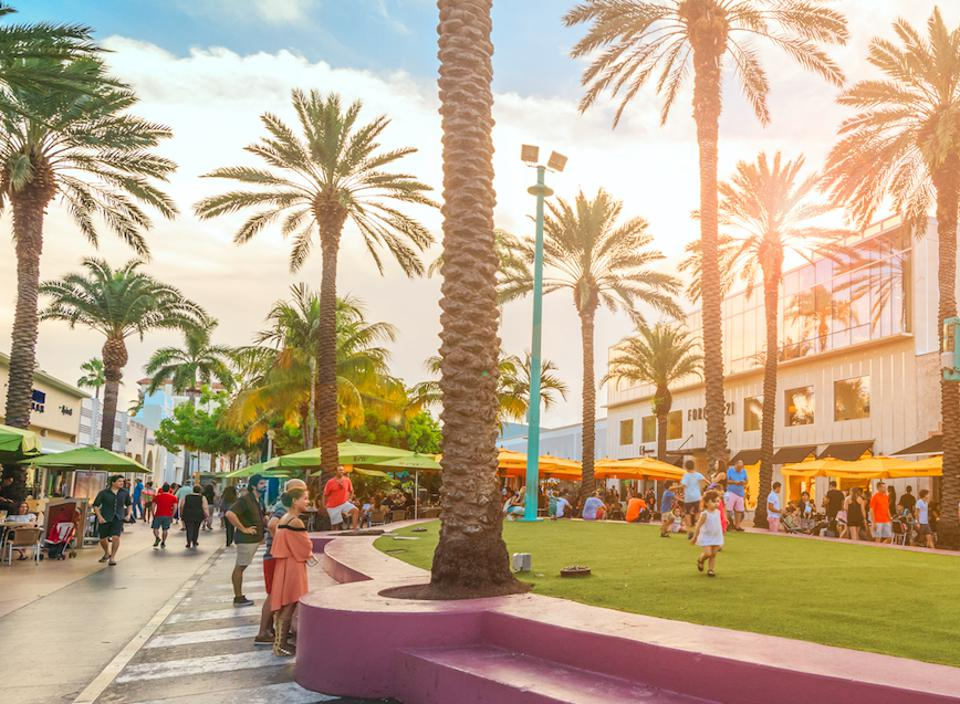 Miami Beach's iconic Lincoln Road with people enjoying a sunny day