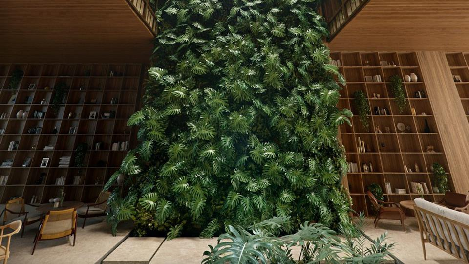 A hotel lobby with a huge garden of ivy growing up the wall