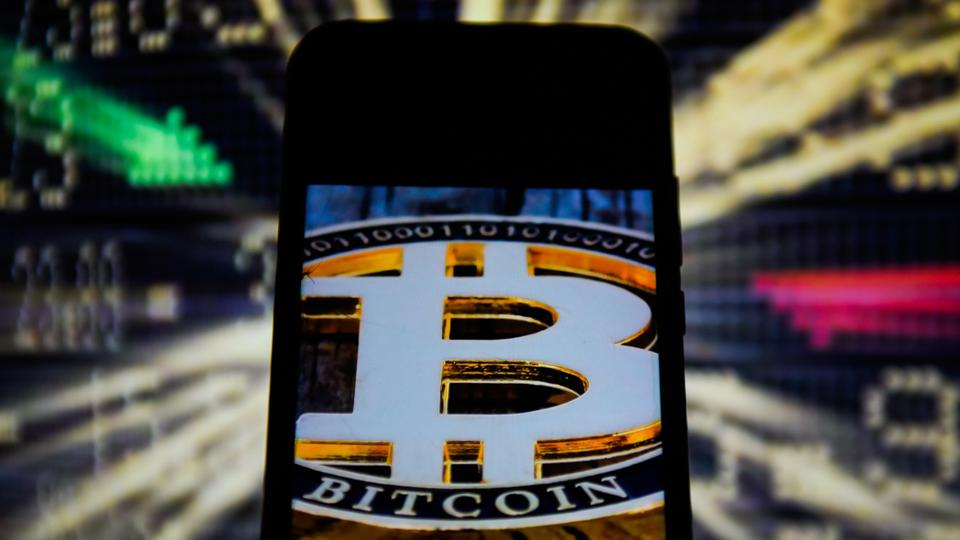 In this photo illustration a Bitcoin logo is seen displayed...