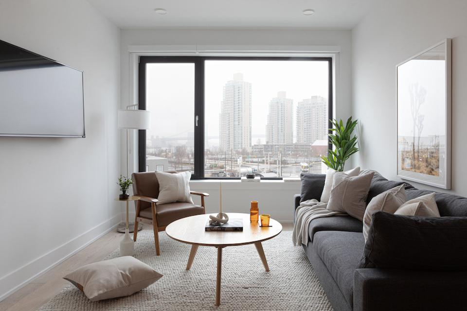 A living room with a view of Philadelphia