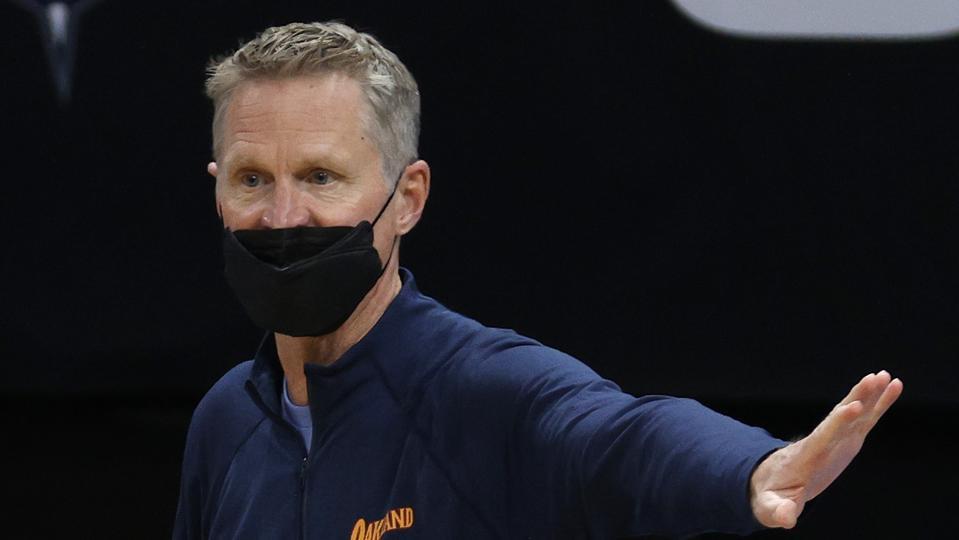 Head coach Steve Kerr of the Golden State Warriors reacts following a play.