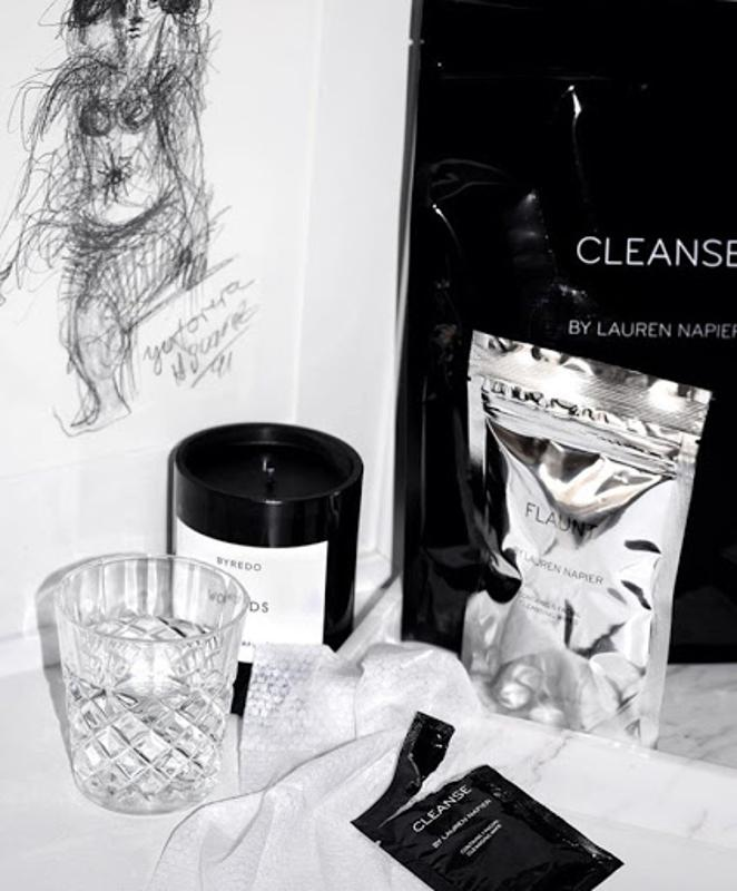 Lauren Napier Beauty wipes in silver packaging on white counter top.