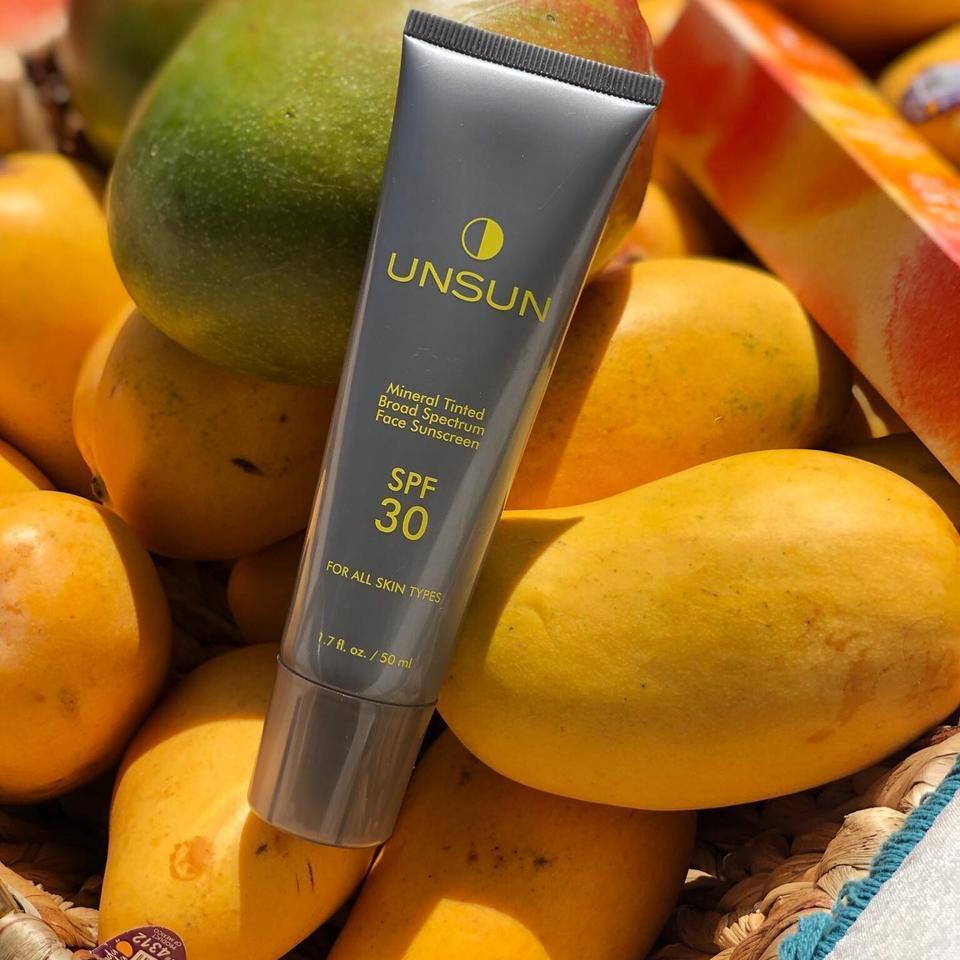 UnSun sunscreen laying atop mangos.