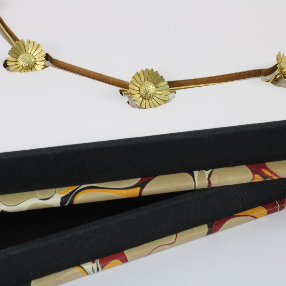 Against Nature: Daisy Chain, 18k gold presented in marbled box, by Christopher Thompson-Royds