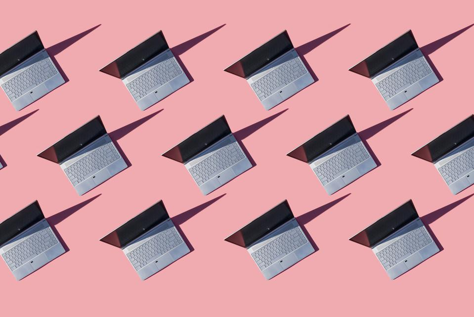 Laptops on pink background